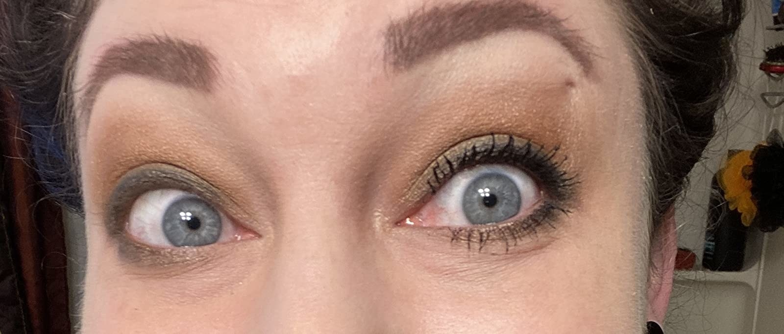 reviewer photo showing the false lash on one eye and the other without