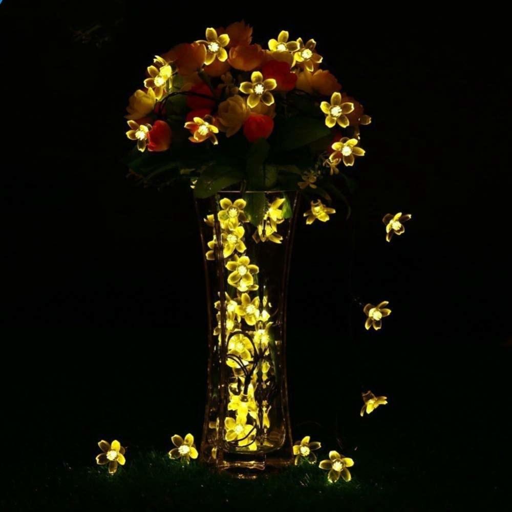 String lights decorating a flower vase.