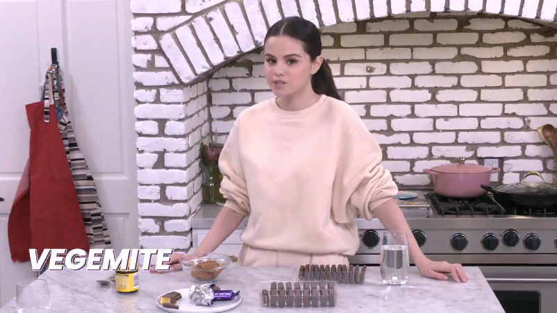 Selena in her kitchen with her hands on the table