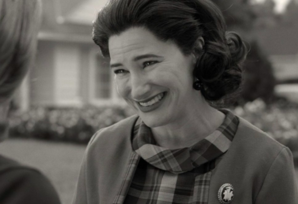 Agnes in '60s costume smiles at Wanda