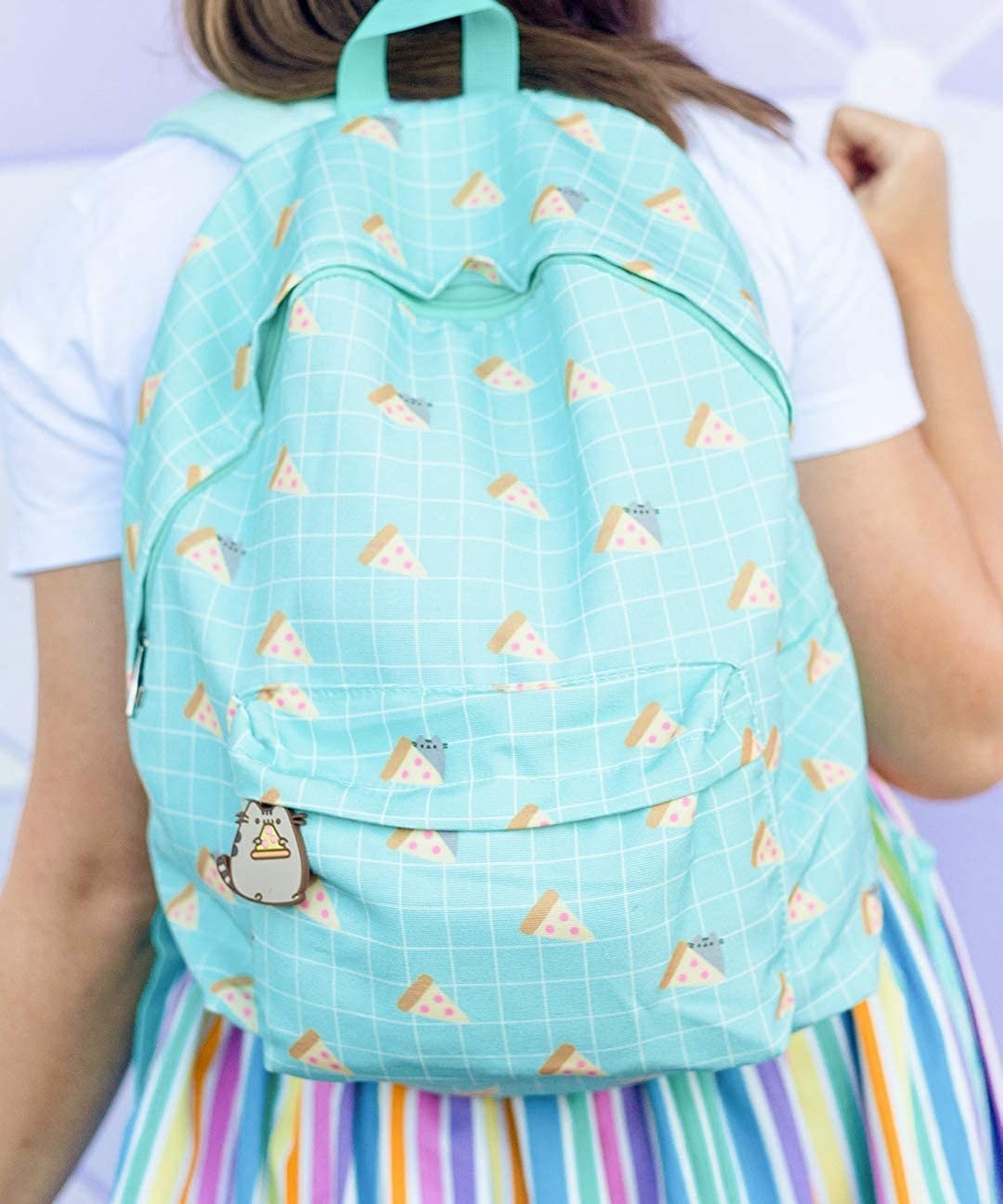 The mint and white grid print backpack printed with pizza slices and Pusheen, with a Pusheen eating pizza zipper pull on the front pouch