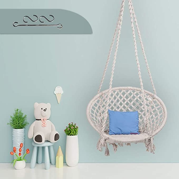 Hanging white macrame swing chair.