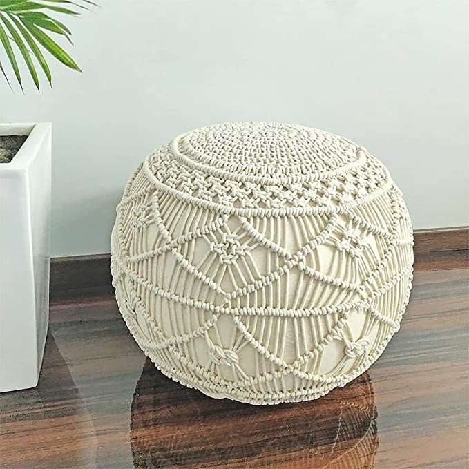 Knitted white ottoman.