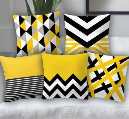 Yellow, black and white geometric pillows.