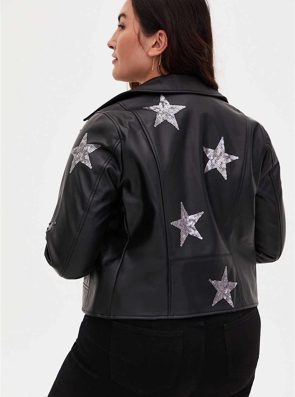 model wearing the black jacket with stars