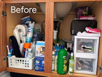 A reviewer's before photo of their disorganized cabinets