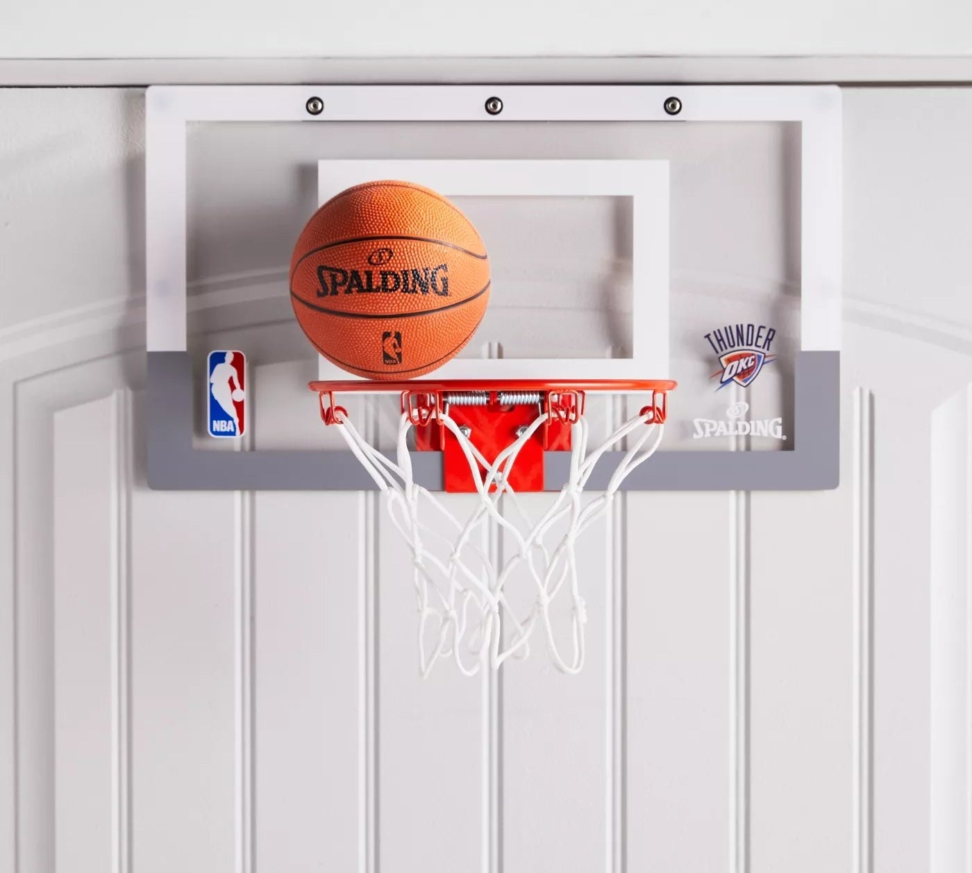 The Spalding basketball hoop and mini rubber ball