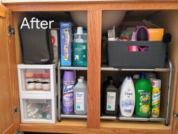 The same reviewer's after photo which shows the cabinet organized with the two-tier shelf