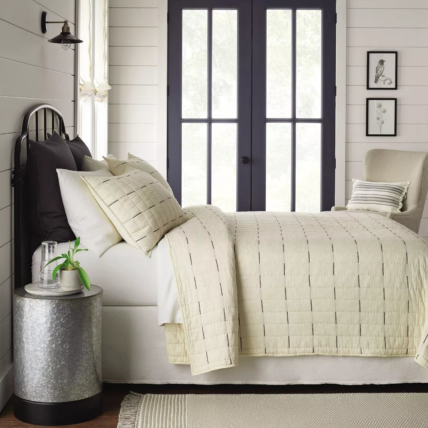 The beige quilt with gray stripes