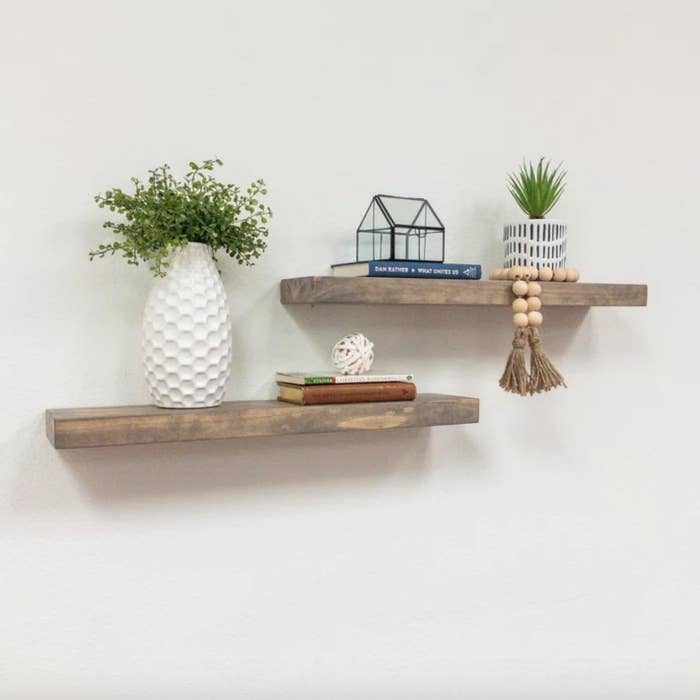 The set of two pine wood floating shelves in dark walnut
