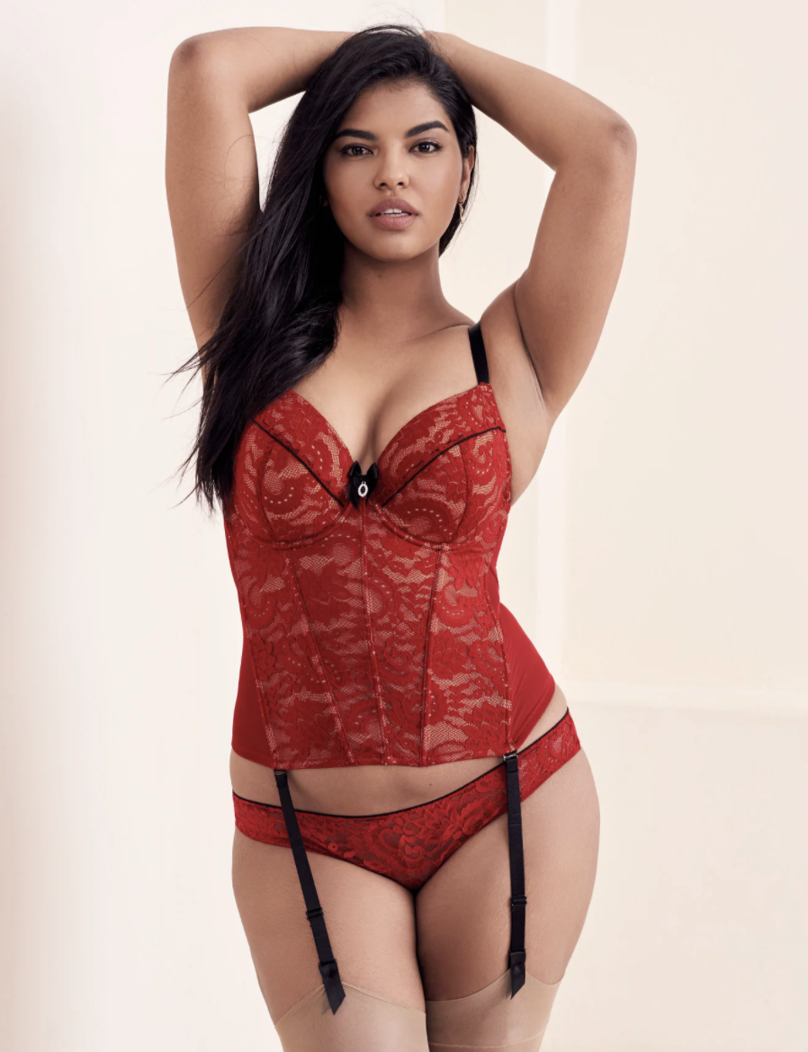 a model in a red corsette with matching red lace panties