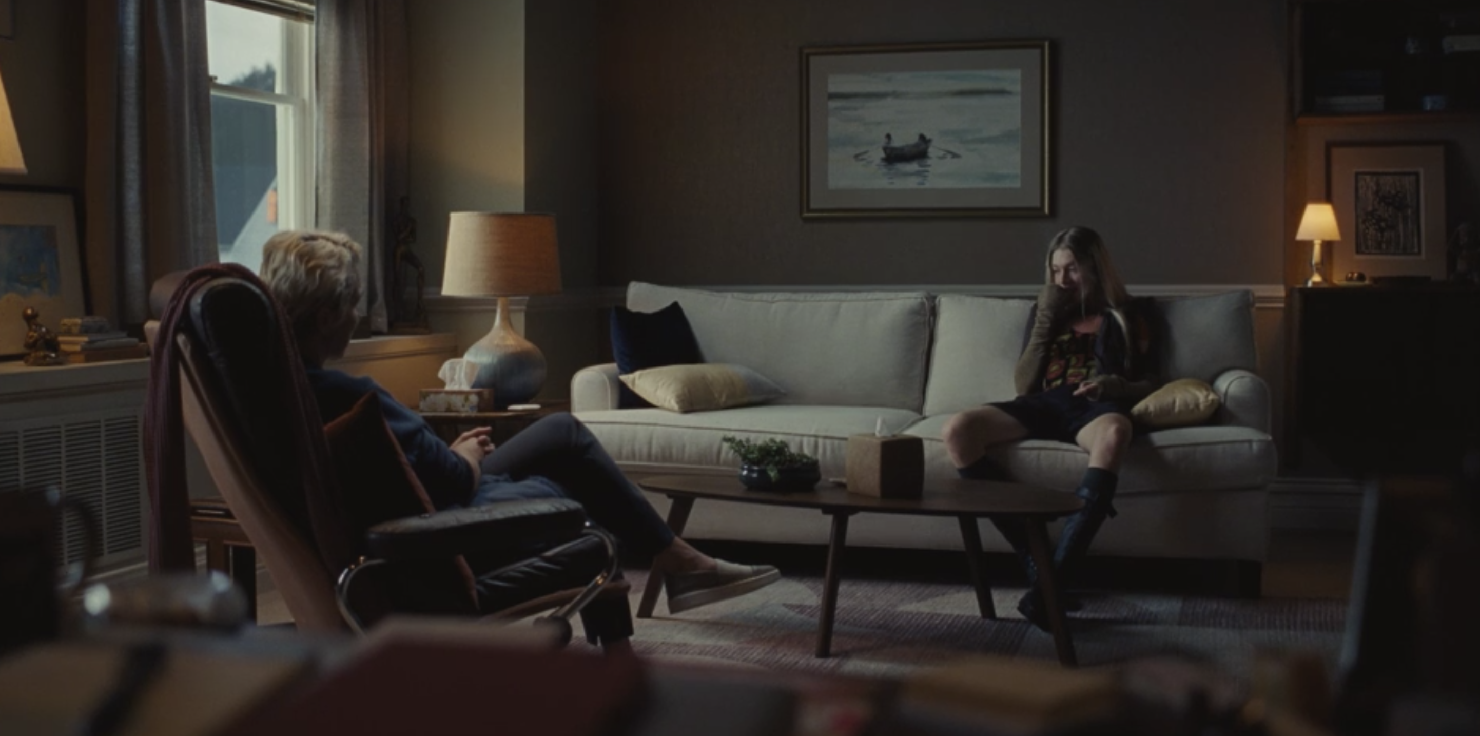 Jules sitting on a couch and talking to her therapist