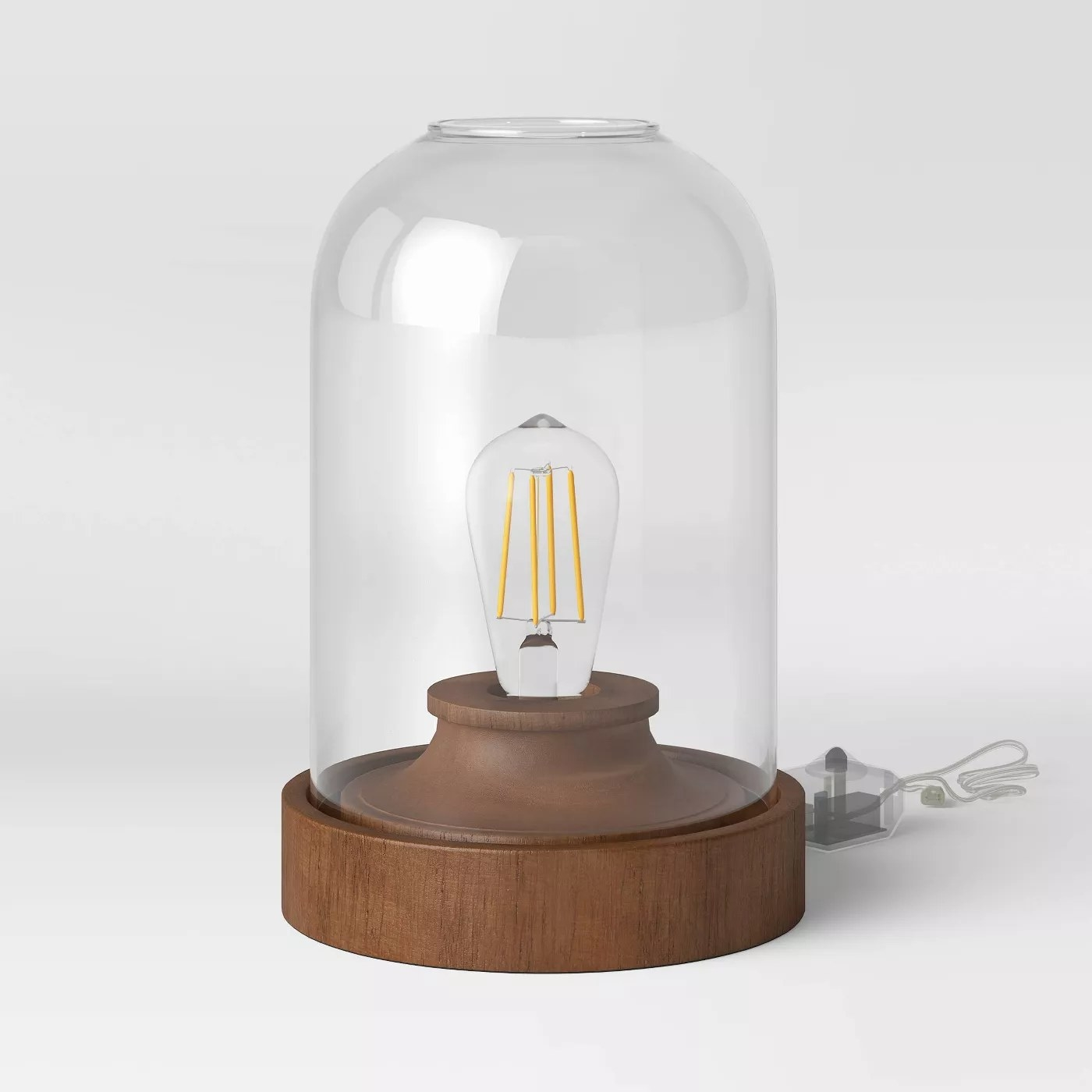 The brown-based lamp with a glass dome top