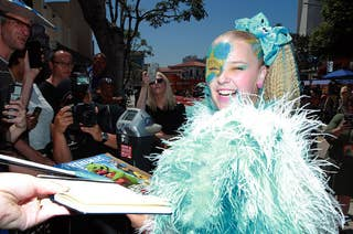 JoJo Siwa signing autographs at a press event