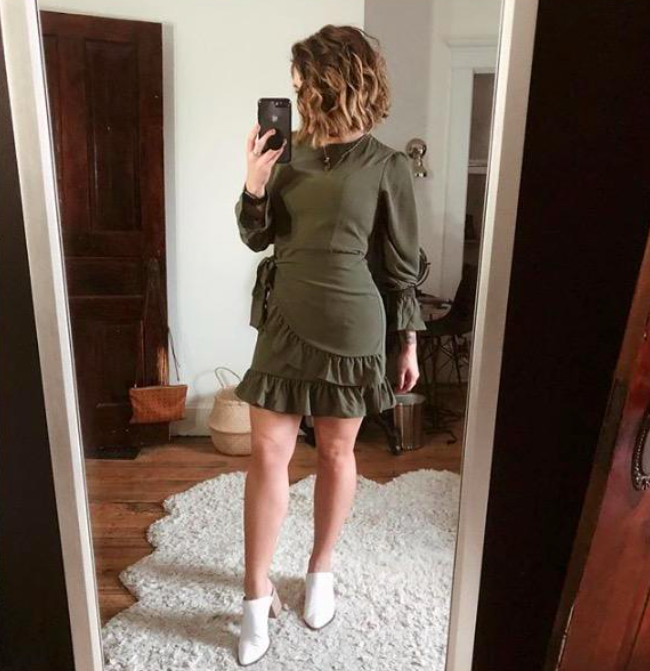 A customer review photo of them wearing the dress in army green
