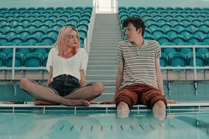 Maeve and Otis from sex education sitting with their legs hanging in a pool