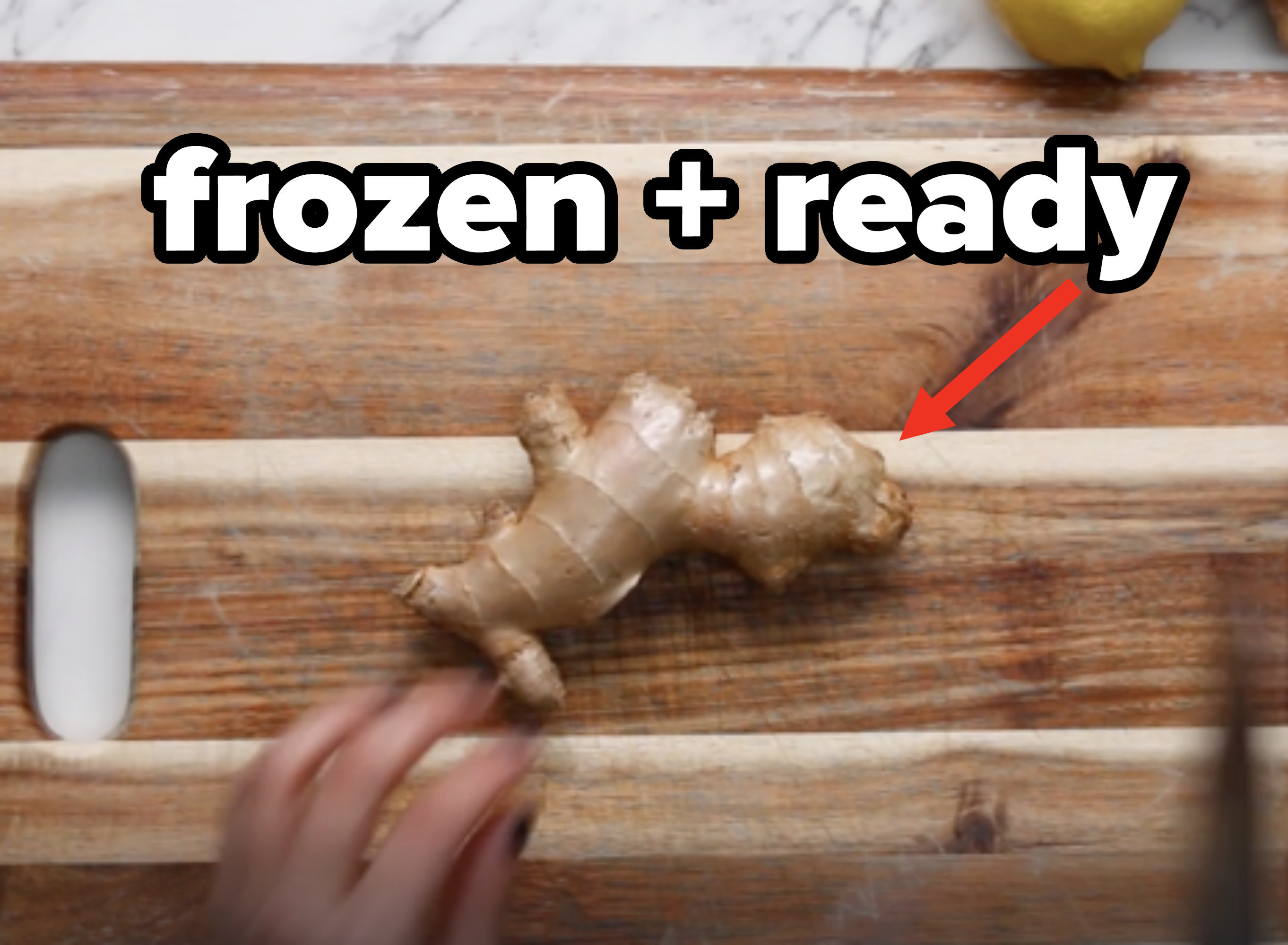 Frozen ginger on a cutting board, ready for grating
