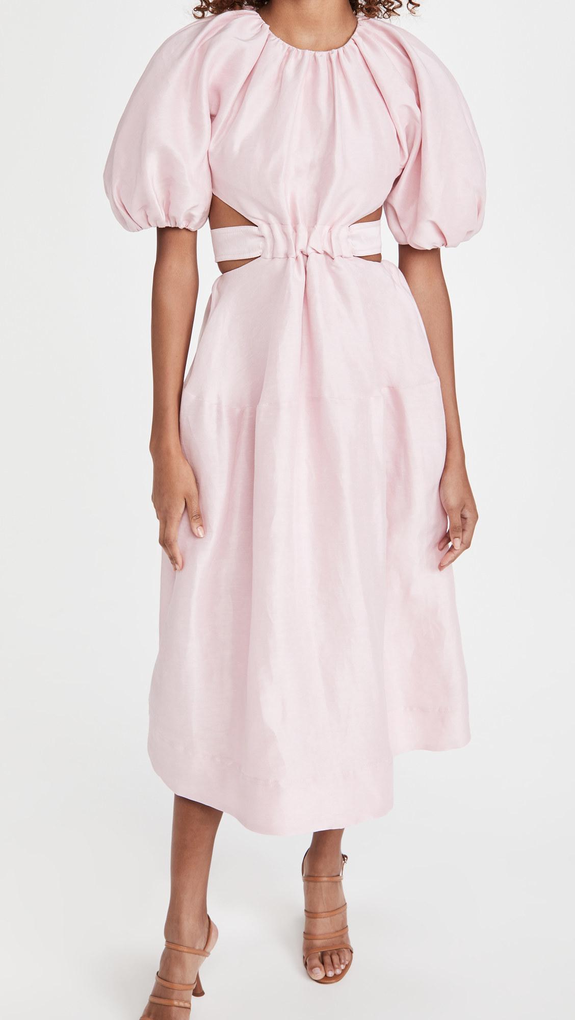 A model wearing the Aje Mimosa Cutout Midi Dress