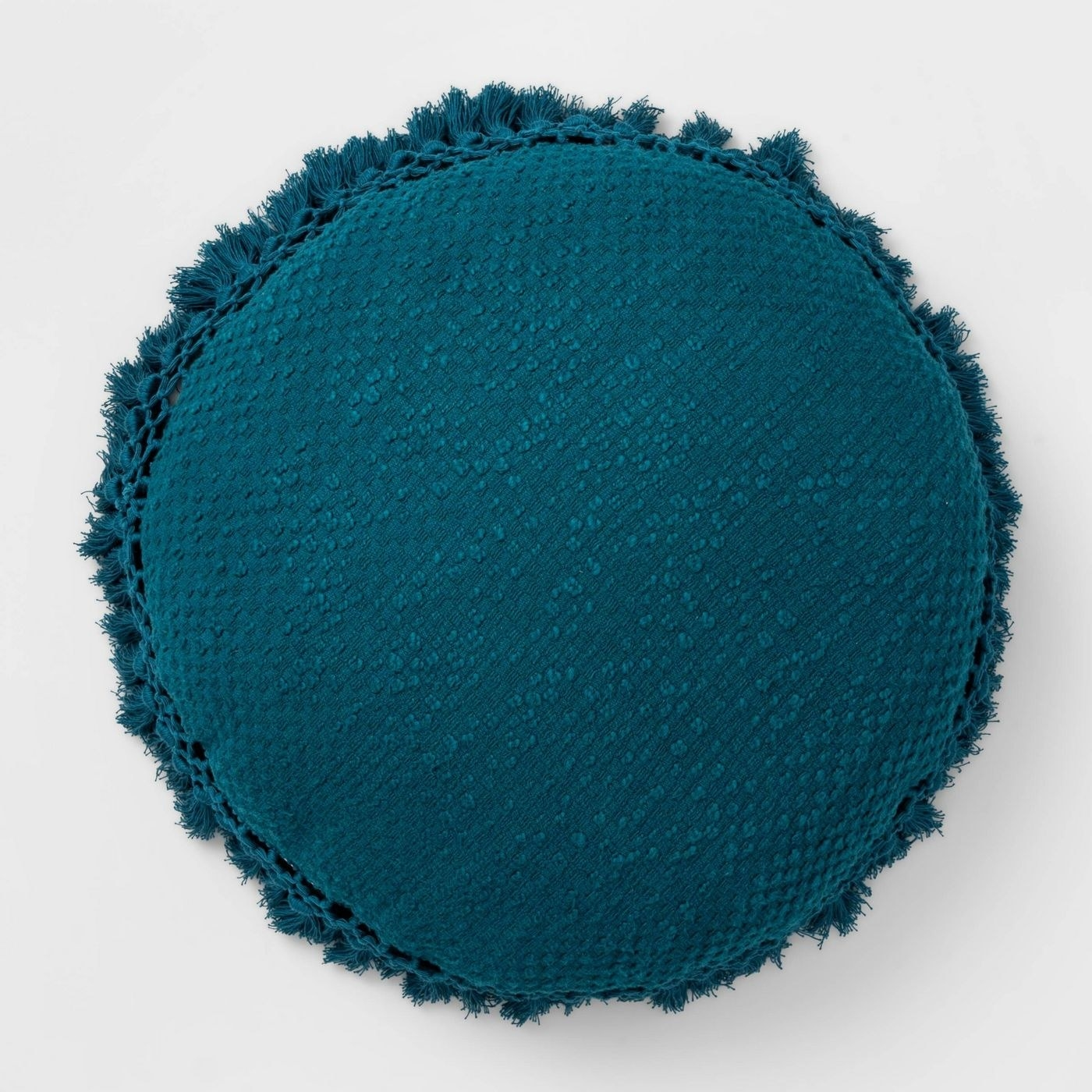 the round teal pillow