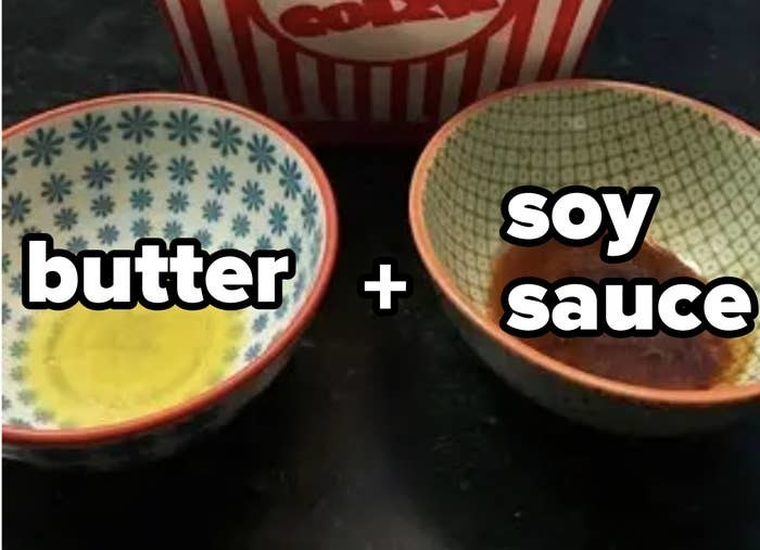 Two bowls next to each other: one filled with melted butter, one filled with soy sauce