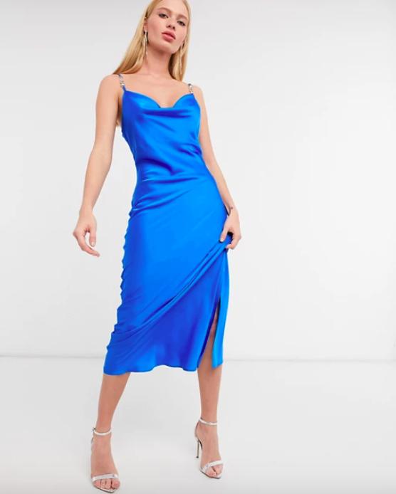 A model wearing the River Island strappy trim midi slip dress in blue