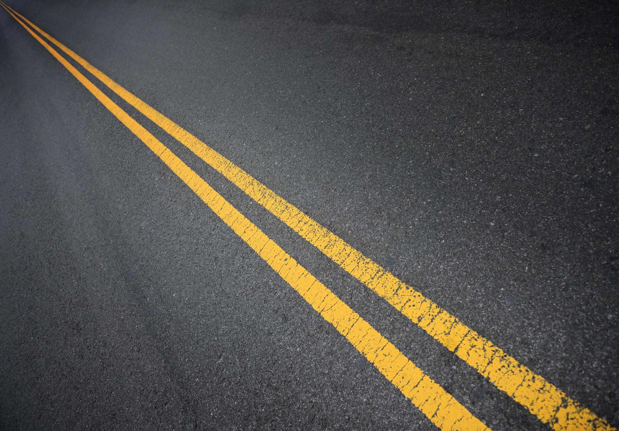 American yellow lines on street