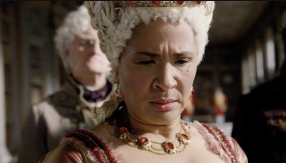 Queen Charlotte looking at the latest scandal sheet