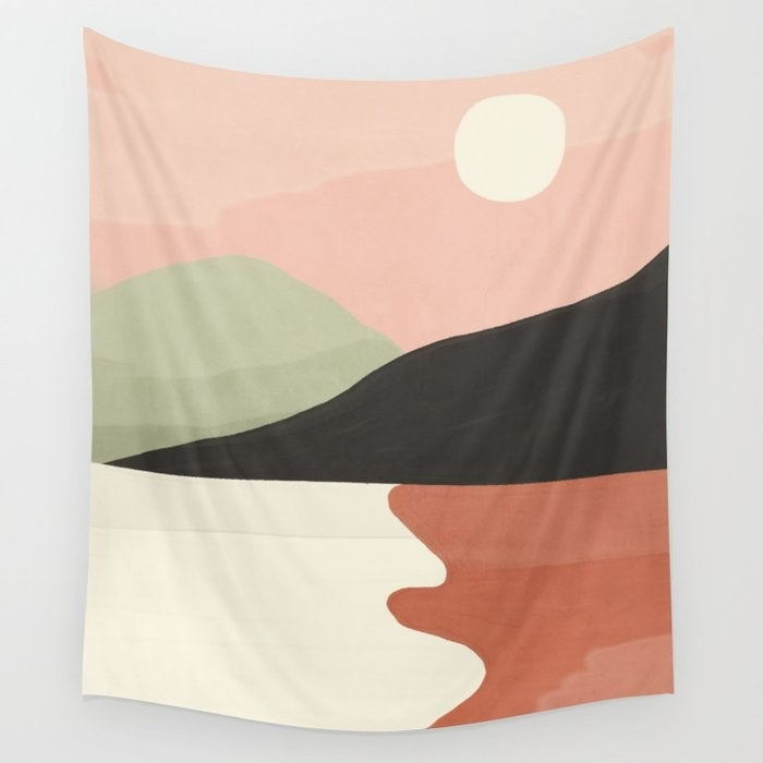 The wall tapestry featuring an abstract landscape