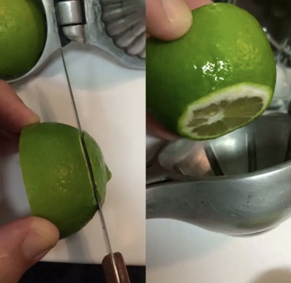 The top of a lime being sliced off with a knife, then put into a hand-juicer