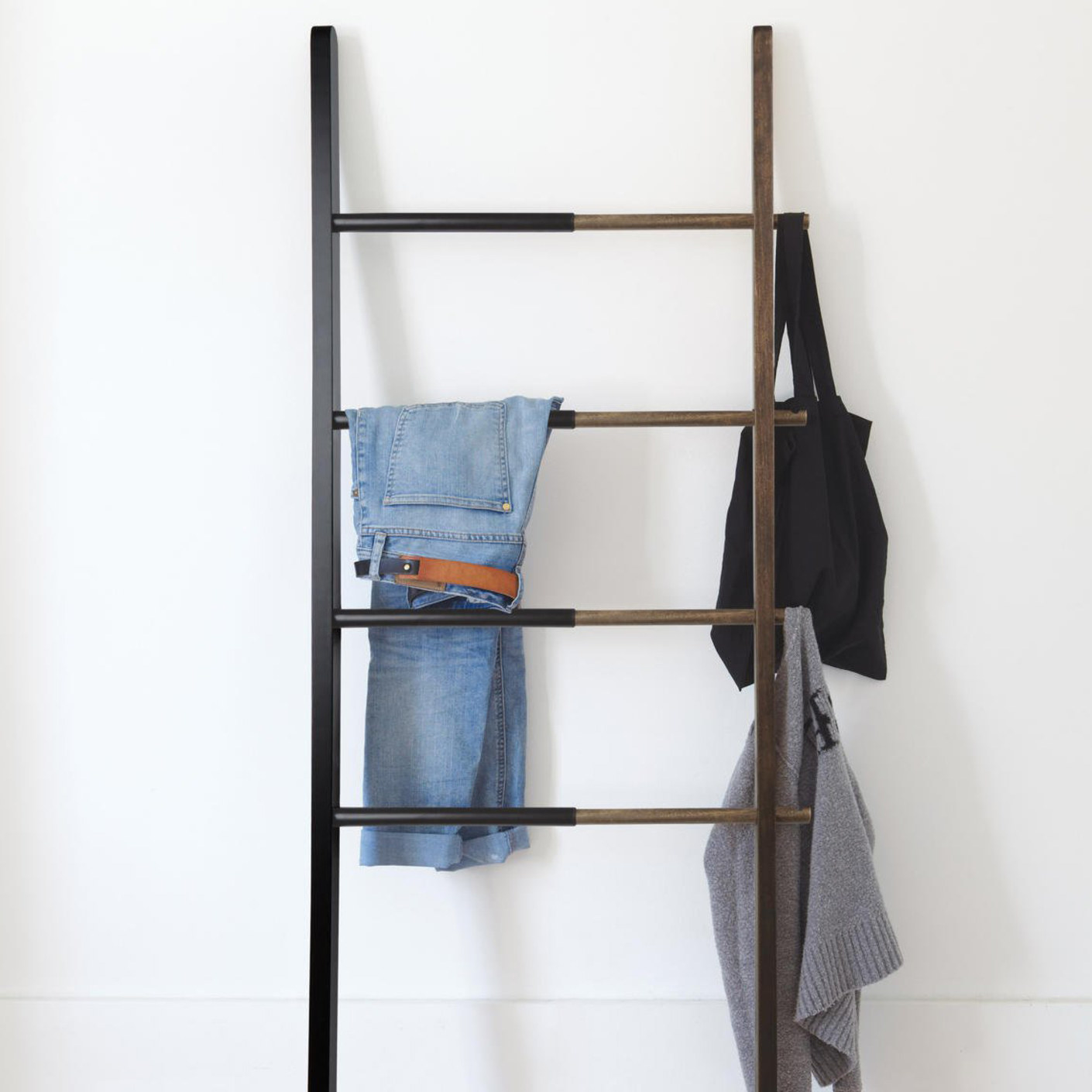 Clothes and bags hanging on the ladder rack