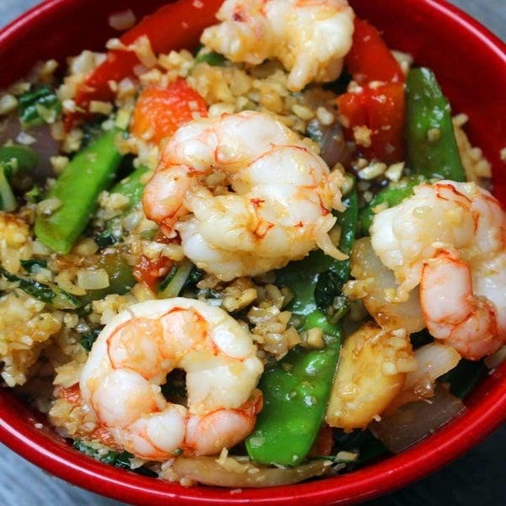 Cauliflower rice and vegetable stir-fry with shrimp.