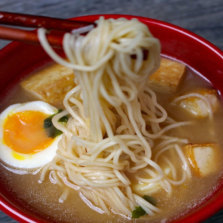 A bowl of ramen with tofu and soft-boiled egg.