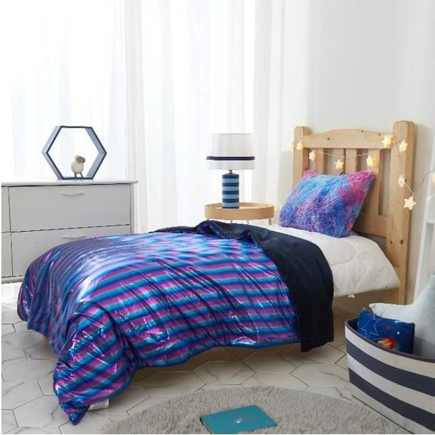 The striped throw on a bed