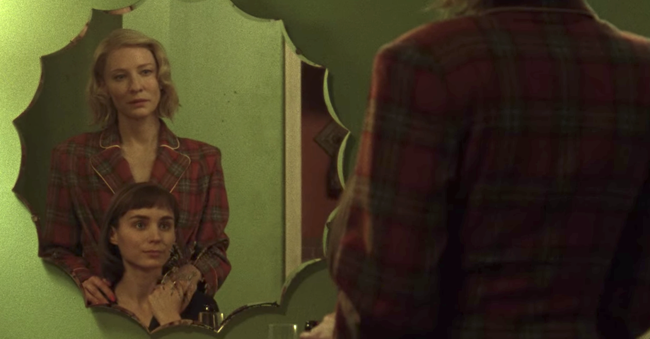 """Cate Blanchett and Rooney Mara staring at each other in a mirror in """"Carol"""""""