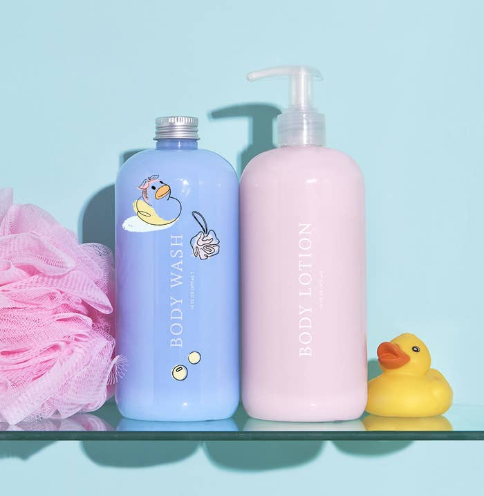 Two bottles of product, one lotion and one body wash, in shower