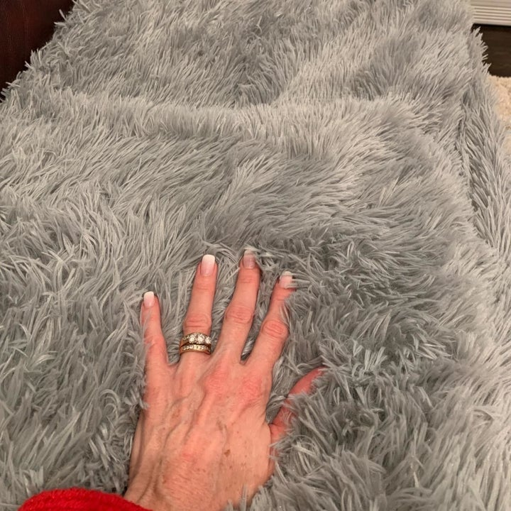 Reviewer's hand showing the softness of the blanket