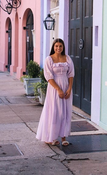 A reviewer wearing the dress in lilac