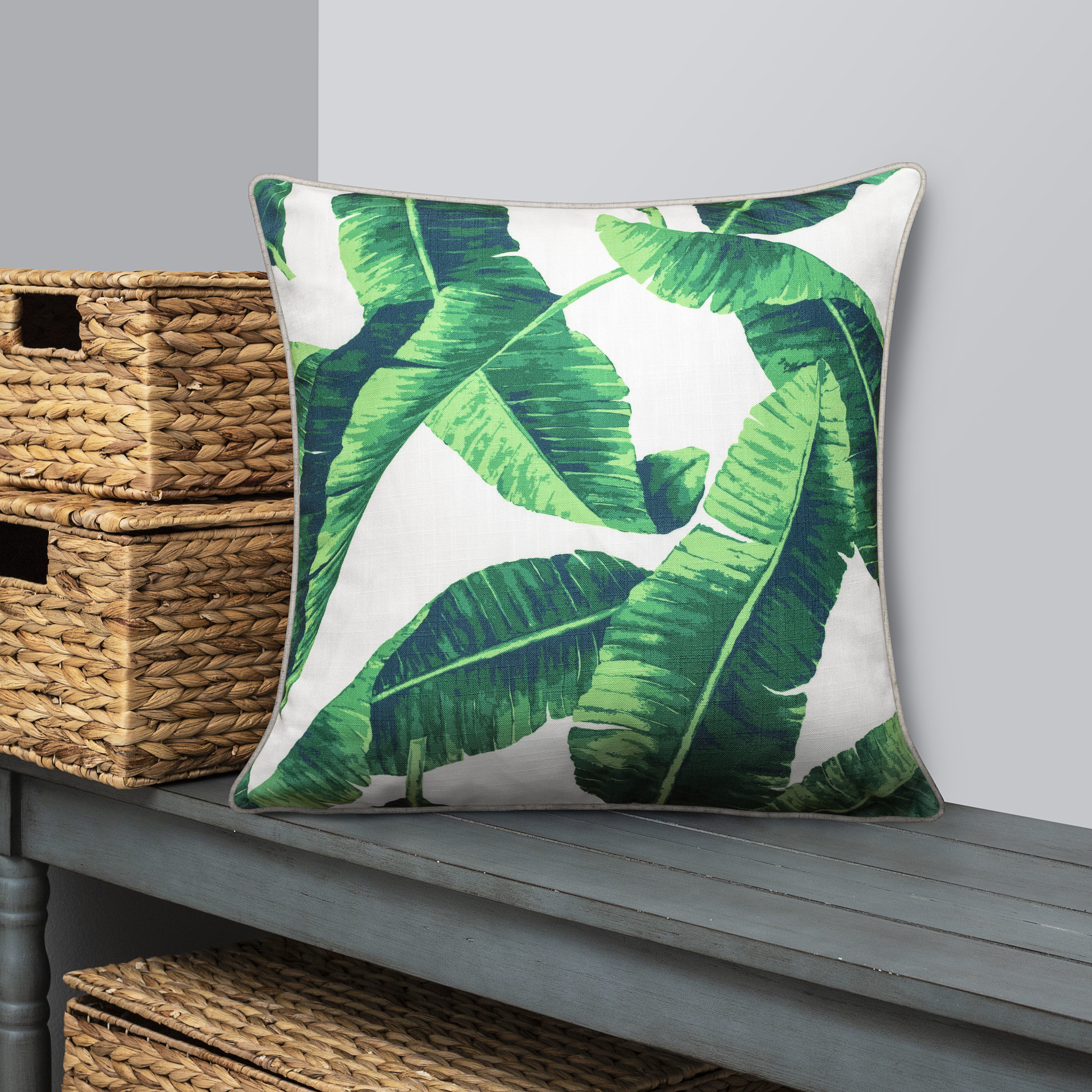 The green and white pillow on a bench