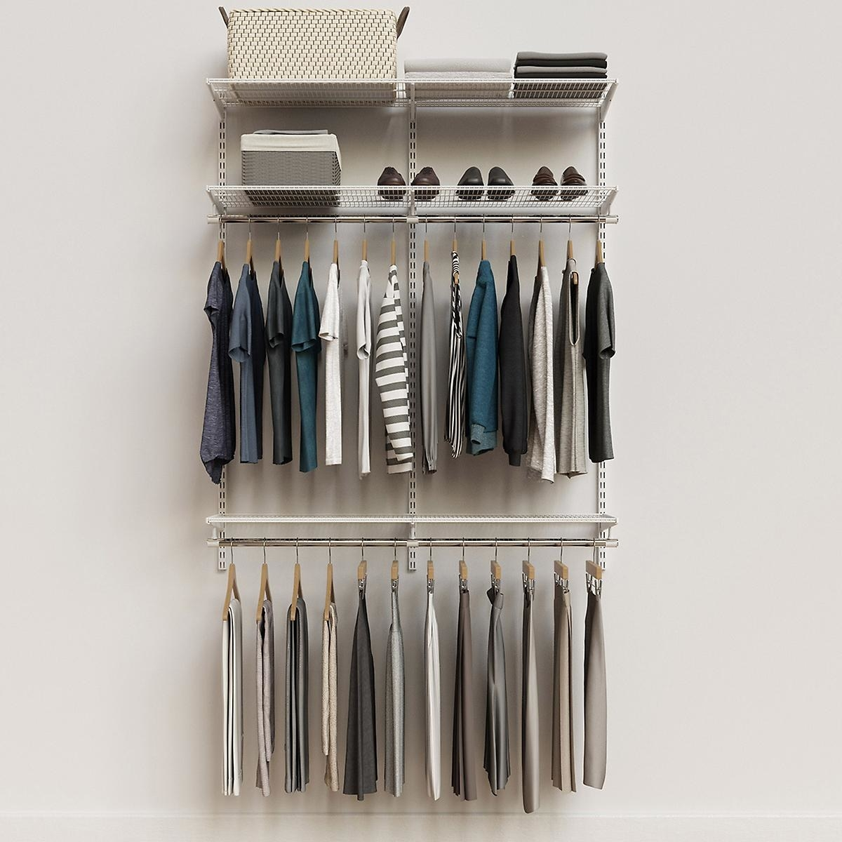 The adjustable closet organizer which has two dowels for hanging clothes and two shelves for baskets/extra storage