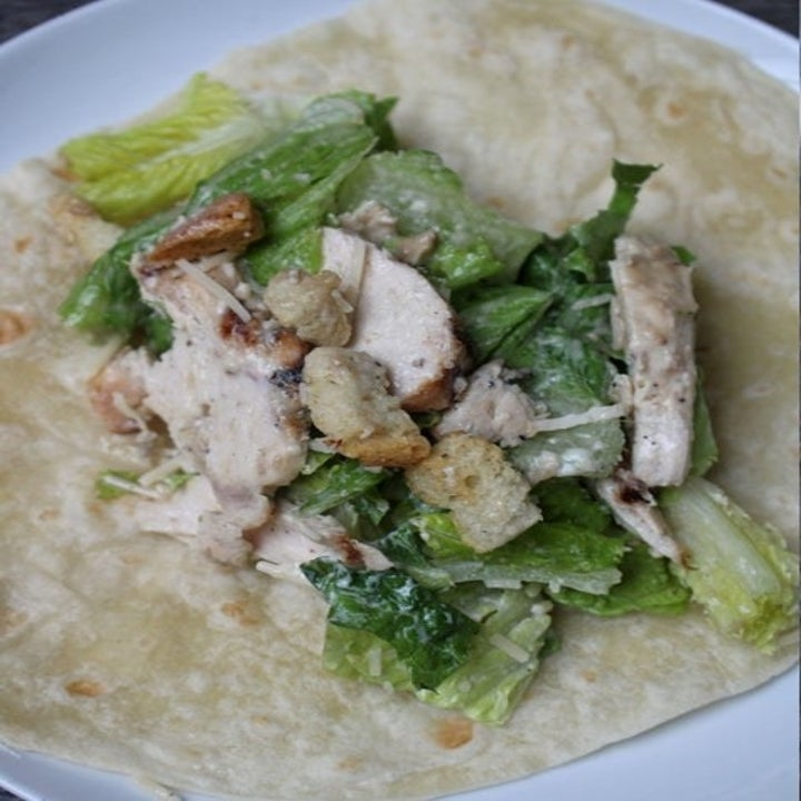 Chicken Caesar salad laid out on a tortilla.