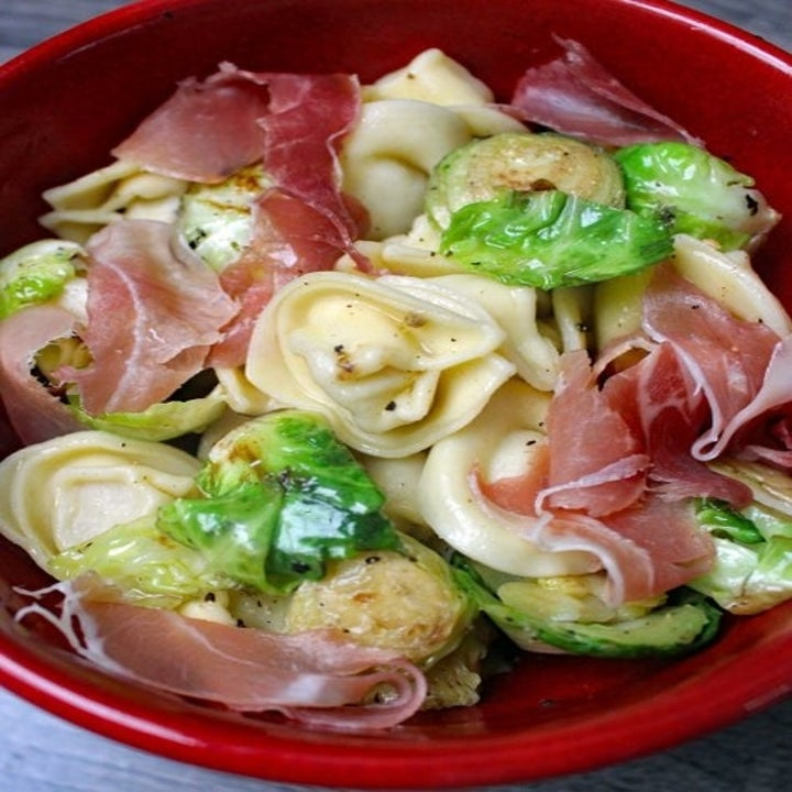 Tortellini pasta salad with Brussels sprouts and prosciutto.