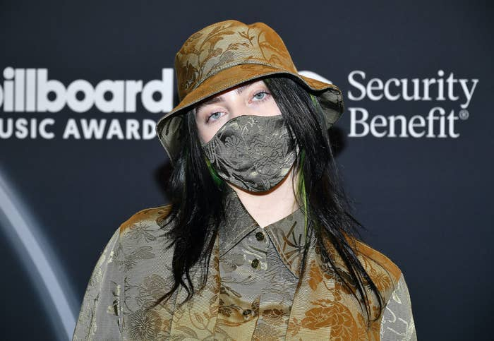 Billie Eilish wearing a bucket hat, face mask, and button-down shirt at the 2020 Billboard Music Awards