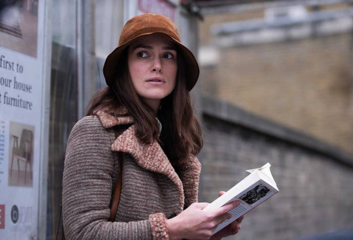 Keira Knightley reads a book in a still from the film Misbehavior