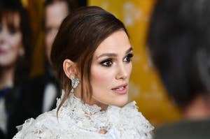 Keira Knightley wearing a white dress at the premiere of
