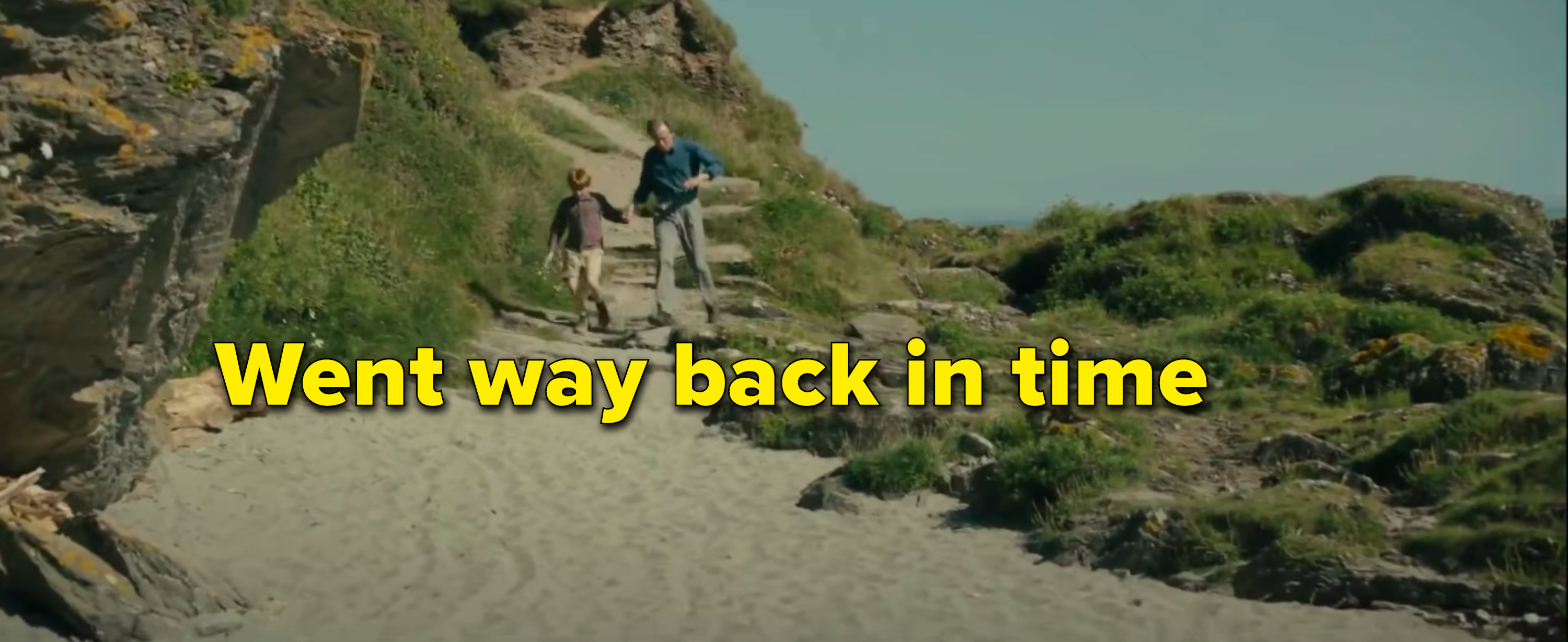 Tim, a child again, runs on the beach with his dad because they went way back in time