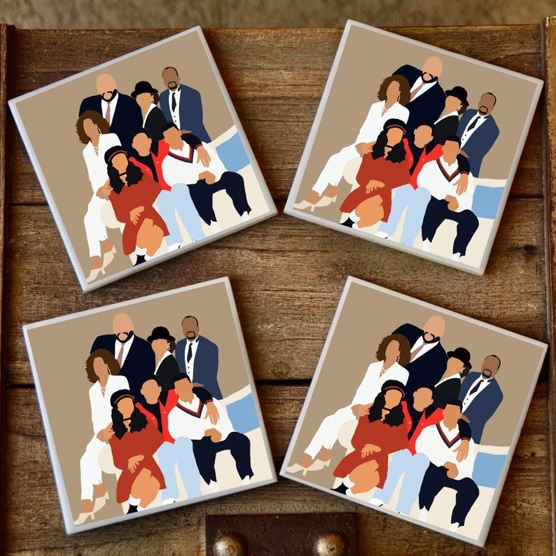 four coasters featuring an illustrated portrait of the whole banks family on a tan background