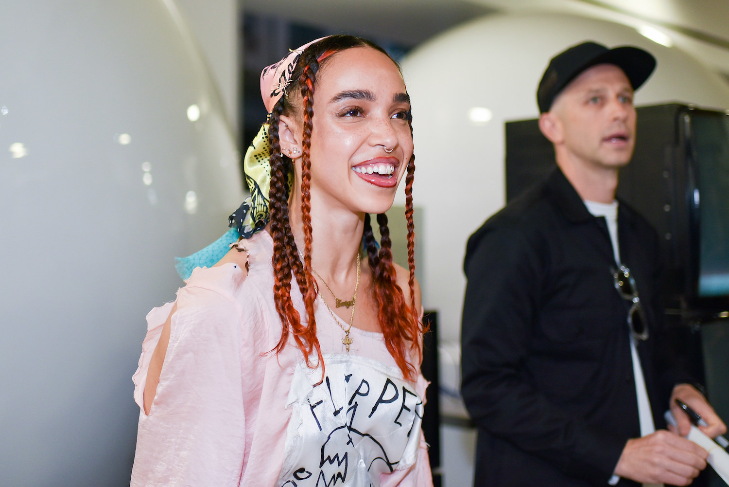 British singer and songwriter FKA Twigs smiles at an event at Dover Street Market during London Fashion Week