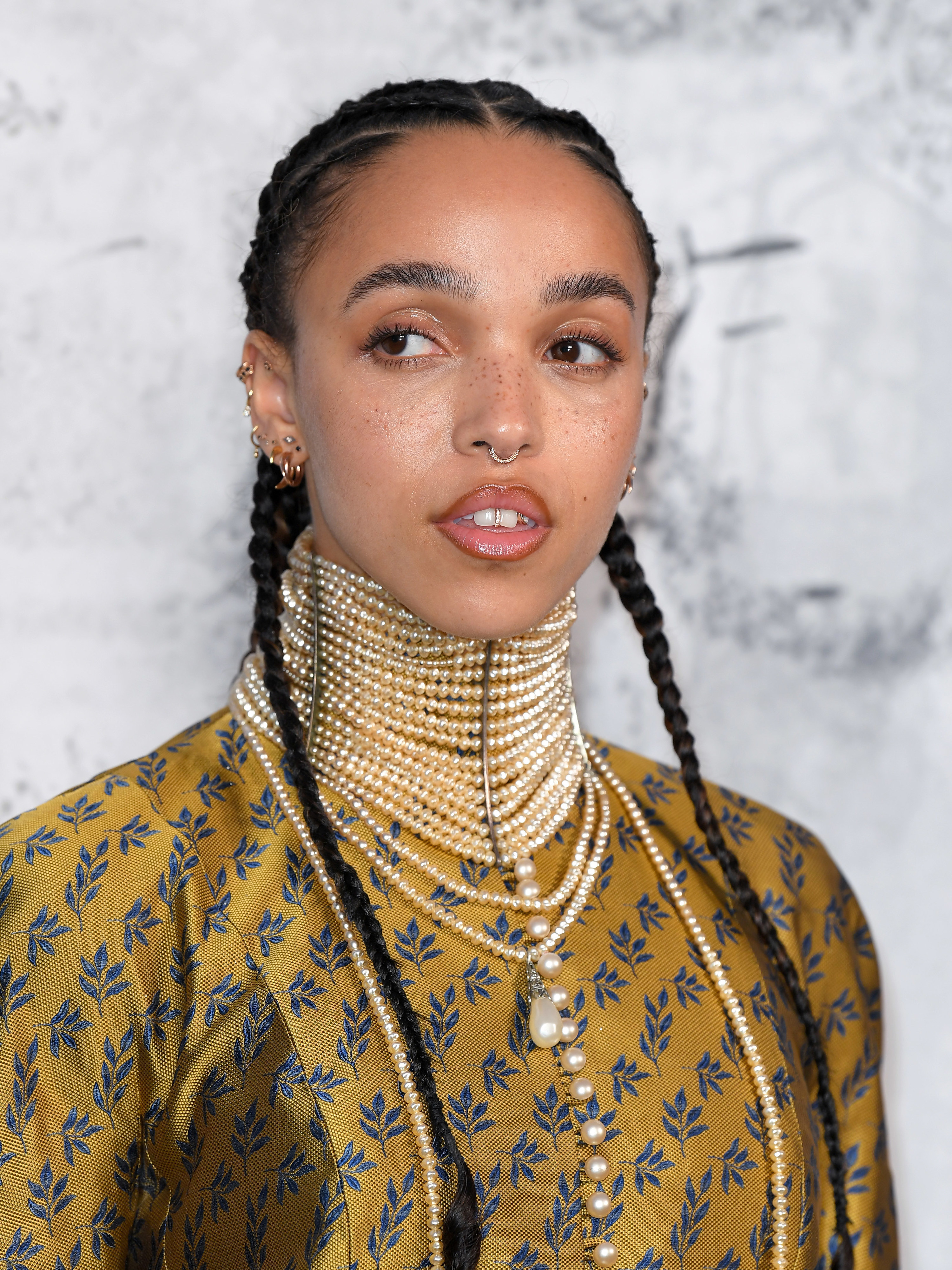 FKA Twigs attends The Summer Party 2019 Presented By Serpentine Galleries And Chanel wearing a high-collared pearl necklace and her hair braided back