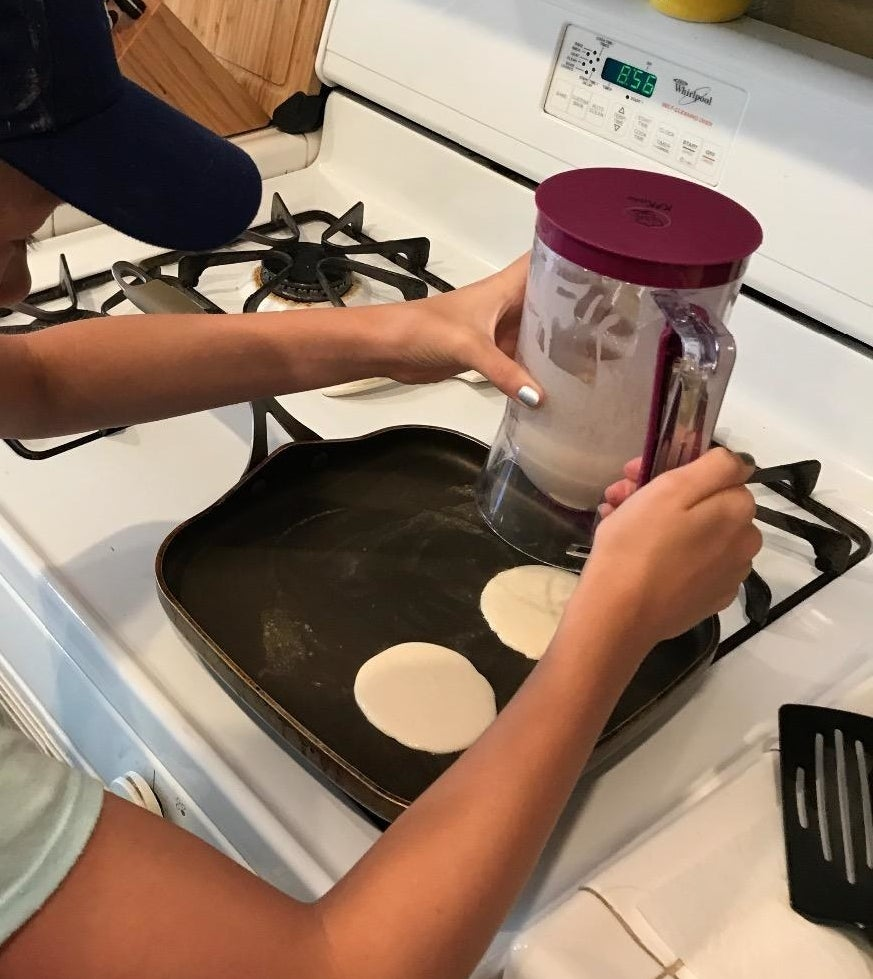 reviewer photo showing person making pancakes with the tool