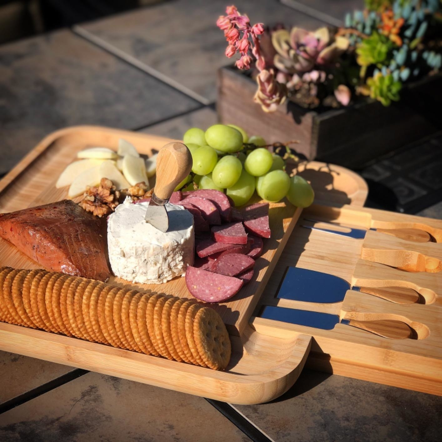 Reviewer photo of meats, cheeses, fruits and crackers placed on charcuterie board
